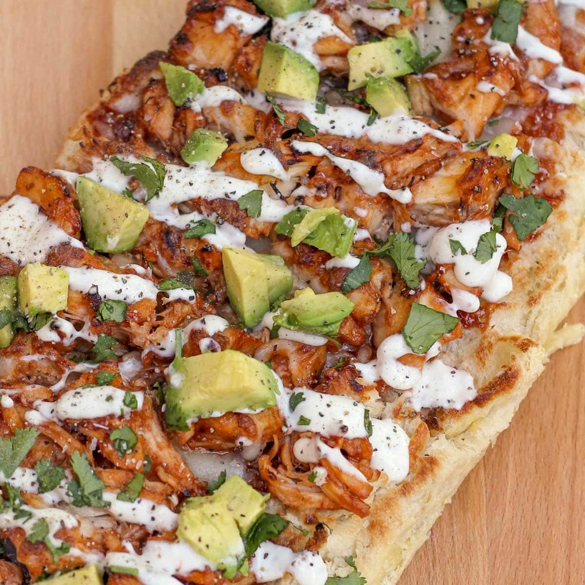 barbecue chicken french bread on a cutting board