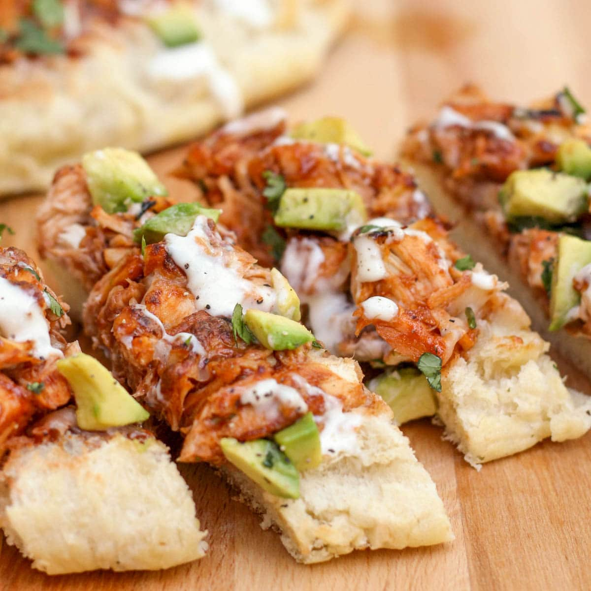 Barbecue chicken french bread sliced on a cutting board