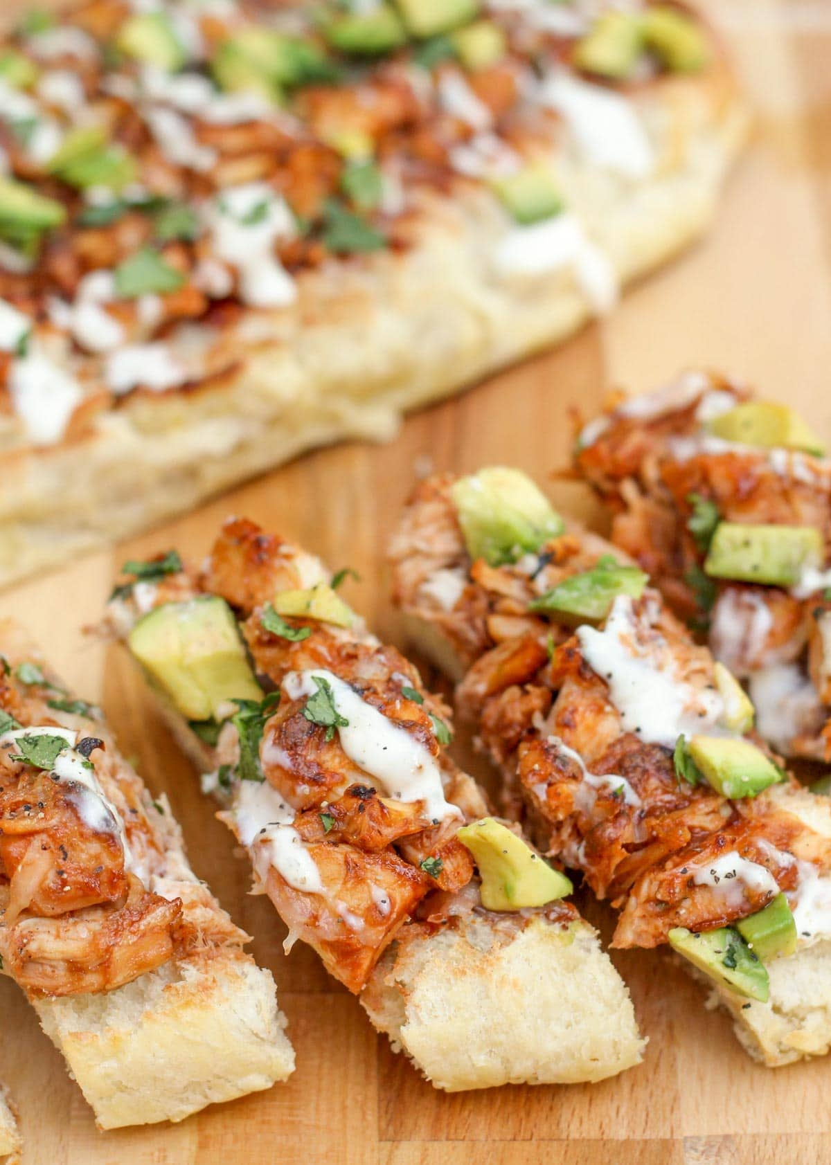 close up of sliced barbecue chicken french bread