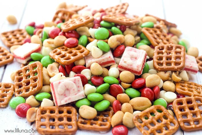 Delicious Christmas Snack Mix - perfect for parties! { lilluna.com } M&M's, pretzels, andes peppermints, white chocolate chips, and peanuts make this a hit!
