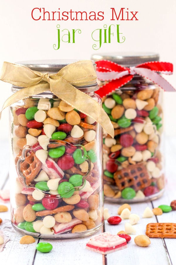 glass jar filled with Christmas snack mix