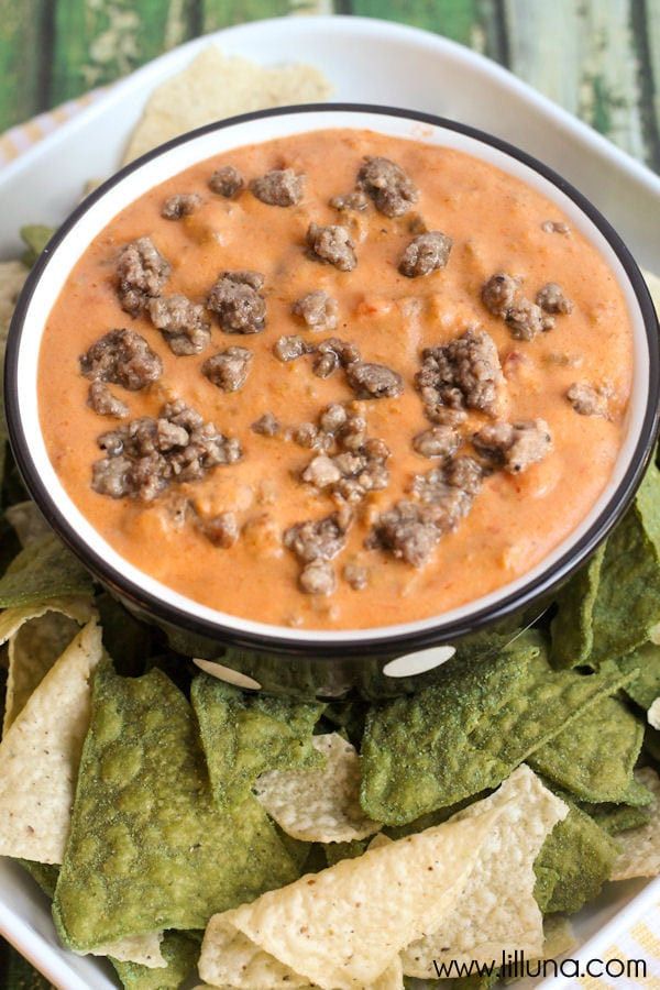 crock pot queso dip in bowl surrounded by chips