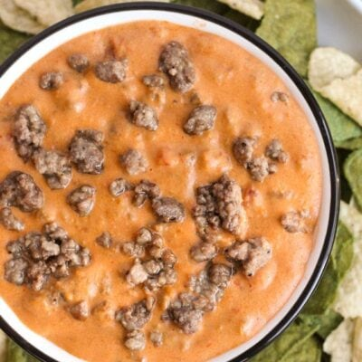 hamburger dip in white bowl with tortilla chips