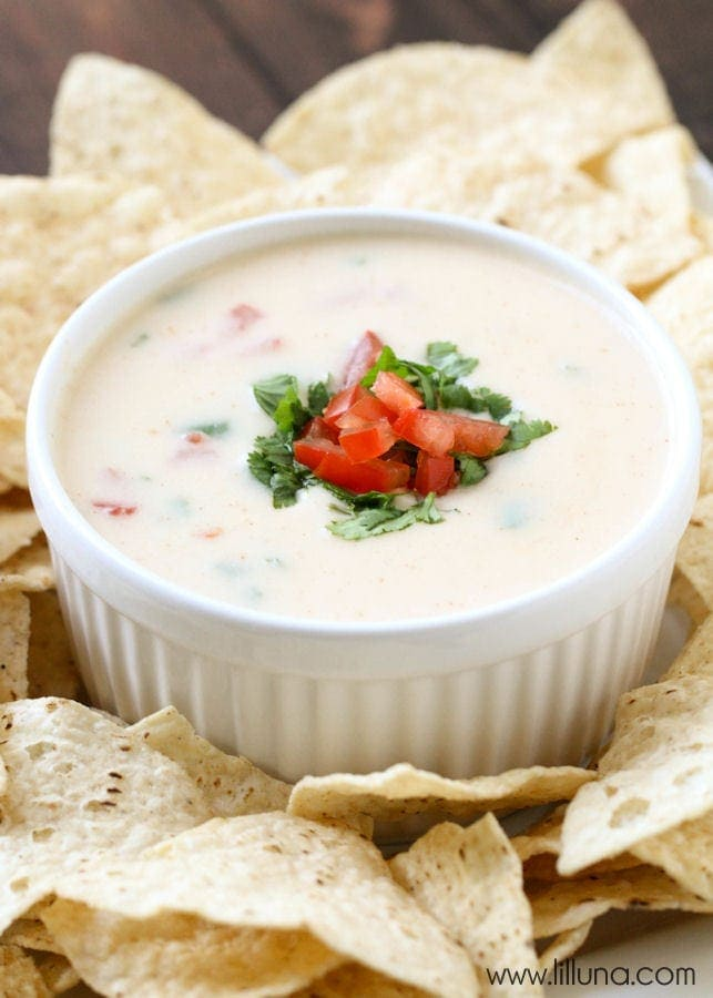 Queso Blanco - a delicious and quick recipe perfect for any party or get together. { lilluna.com } Recipe includes jack cheese, tomatoes, cilantro, onion & chili powder, and milk.