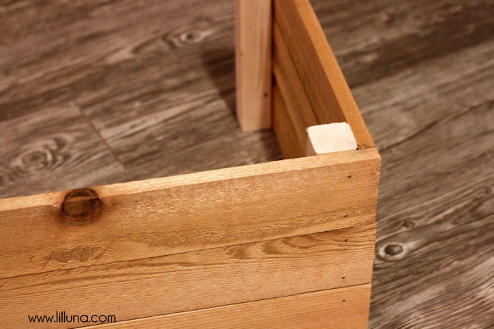 DIY Shoe Bin tutorial - the perfect place to store your shoes! { lilluna.com } Supplies include - boards, wood planks, nails, paint, and basic tools.