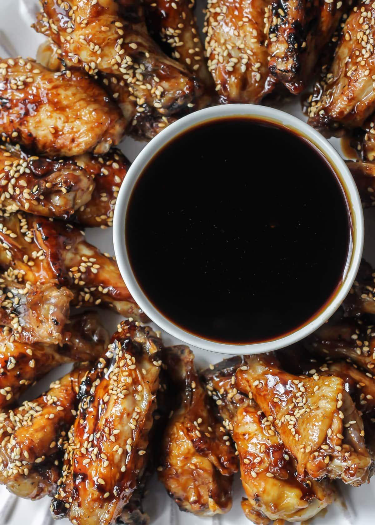 Teriyaki Wings on dish with sauce