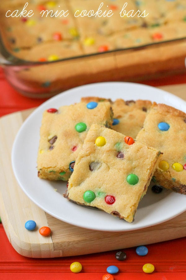 "Simple and delicious Cake Mix Cookie Bars - a great ""go-to"" dessert recipe. { lilluna.com } Recipe includes yellow cake mix, white chocolate or vanilla pudding mix, chocolate chips, & mini m&m's."