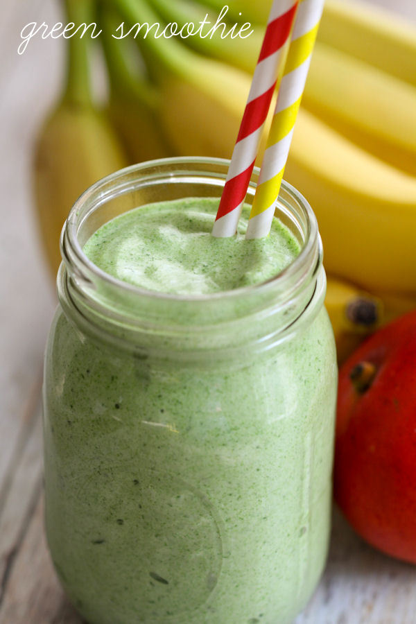 Healthy and Delicious Green Smoothie - packed with fruit-strawberries, bananas, mangos, & pineapple and nutrients! { lilluna.com }