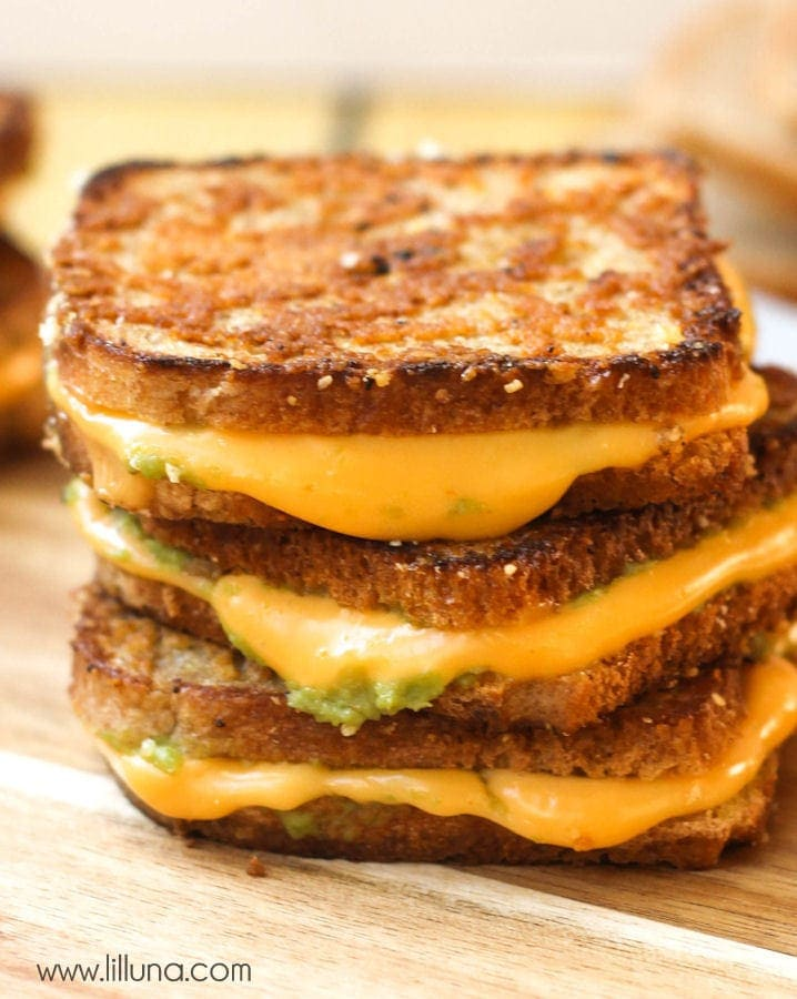 close up of stacked grilled cheese avocado sandwiches