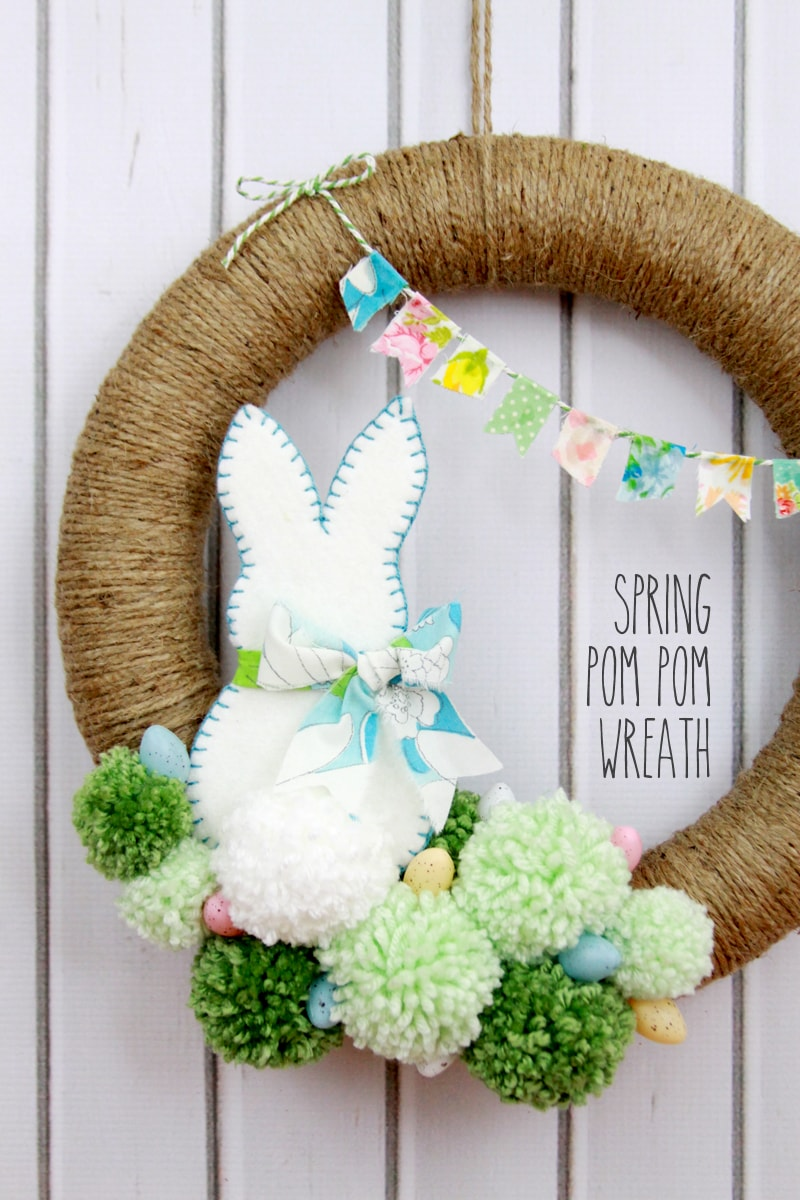 Spring Pom Pom Wreath - so cute! Tutorial on { lilluna.com } Supplies include foam wreath, felt, fabric scraps, and twine.