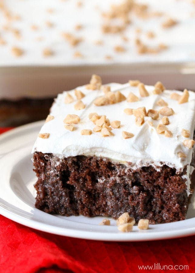 Better than Anything Cake - one of the best and easiest desserts you'll ever try! { lilluna.com } Super moist cake made with chocolate cake mix, caramel sauce, and sweetened condensed milk, topped with cool whip and toffee bits.