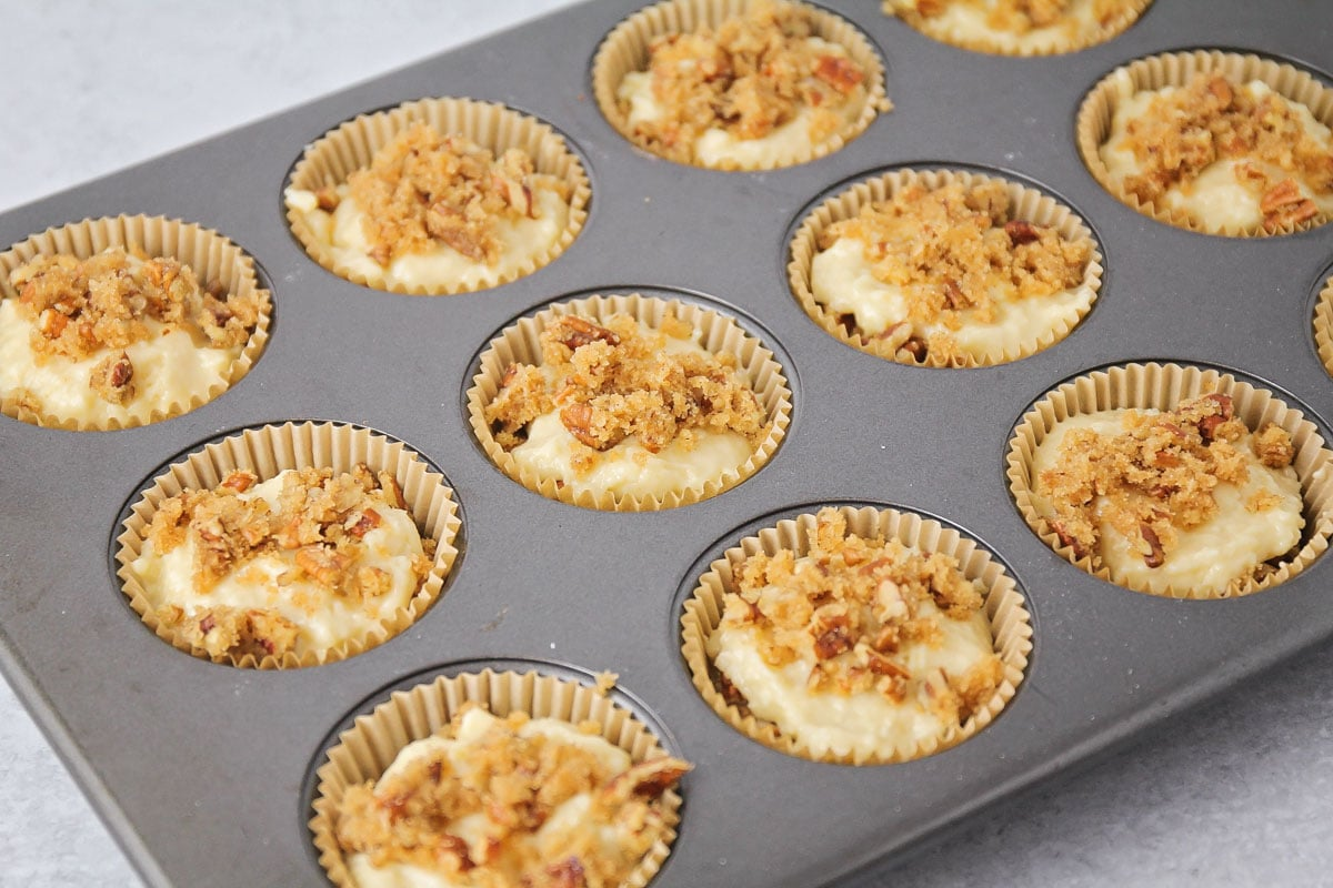 Coffee cake batter with streusel in muffin tin
