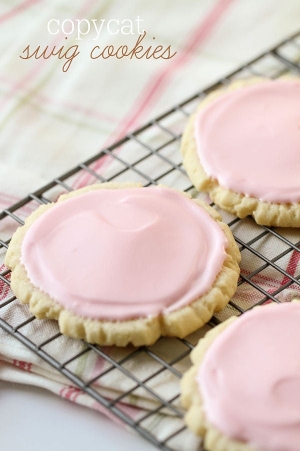 Copycat Swig Cookies recipe - one of the best sugar cookies ever! { lilluna.com } Soft sugar cookies with a frosting made from sour cream, powdered sugar, and almond extract!