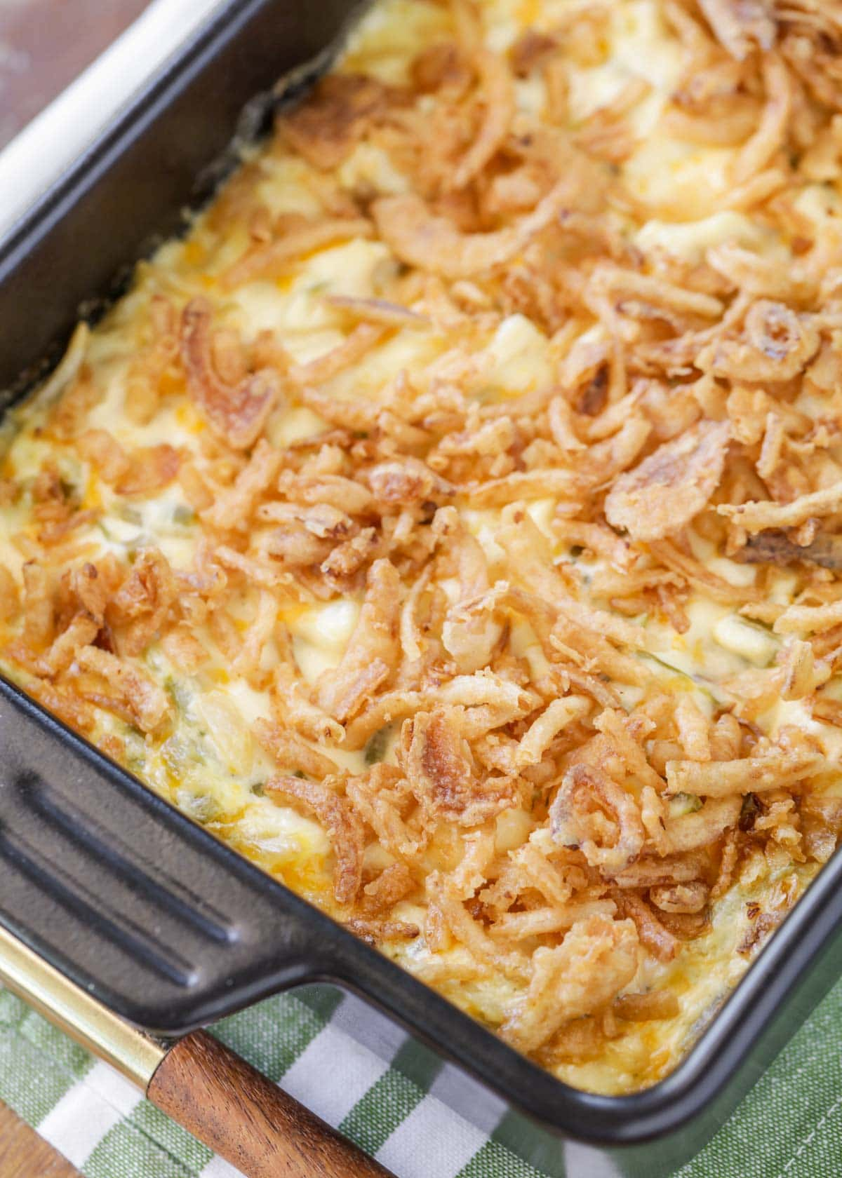 French onion chicken casserole topped with onions in a baking dish