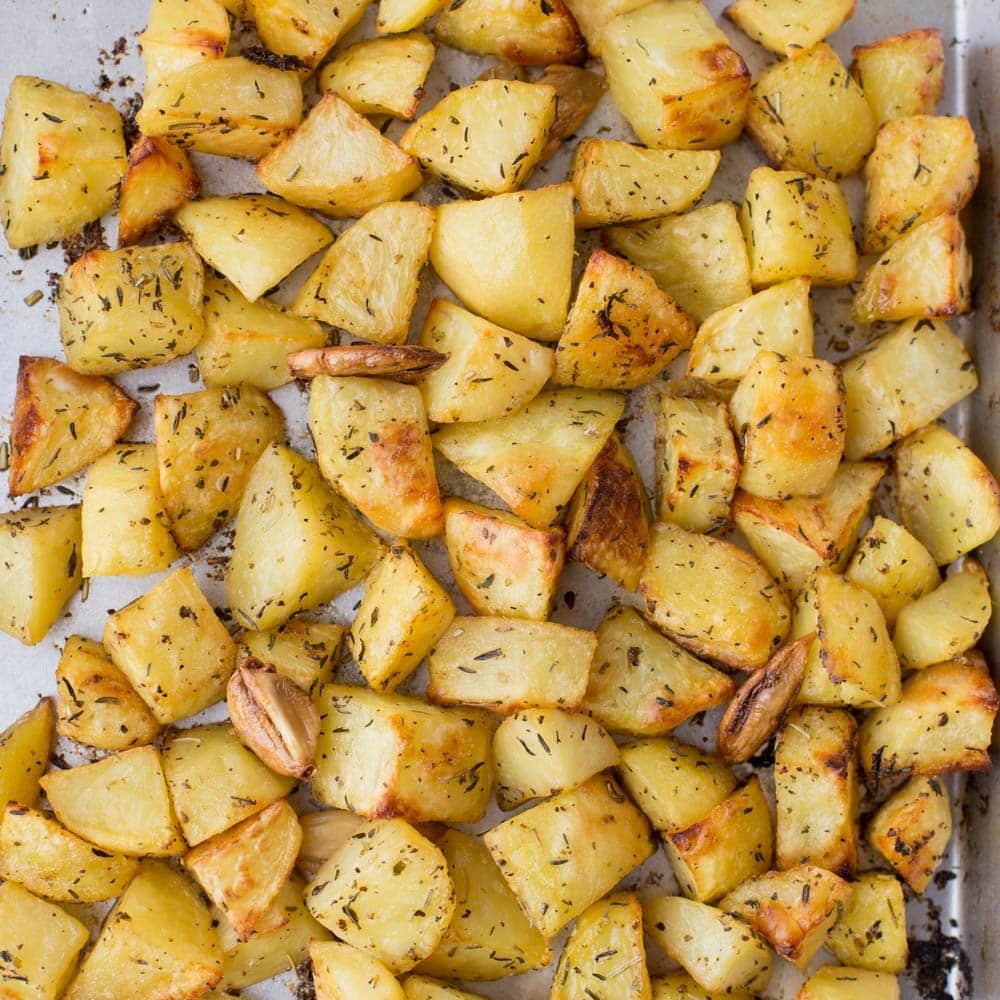 Herb roasted potatoes on baking sheet
