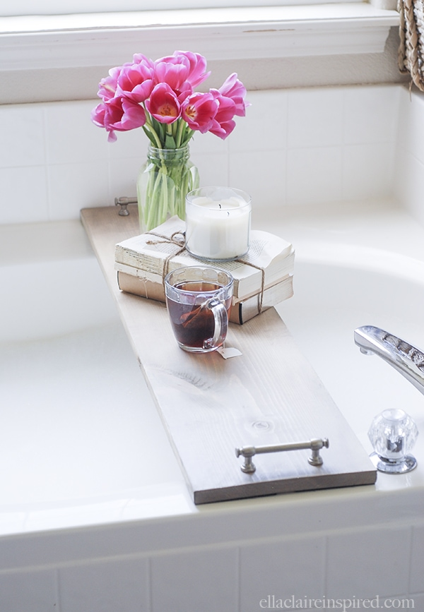 This easy DIY bathtub tray is perfect for drink or your favorite book while you soak! Tutorial on { lilluna.com } All you need is some pine board, stain, cabinet pulls, and sandpaper.