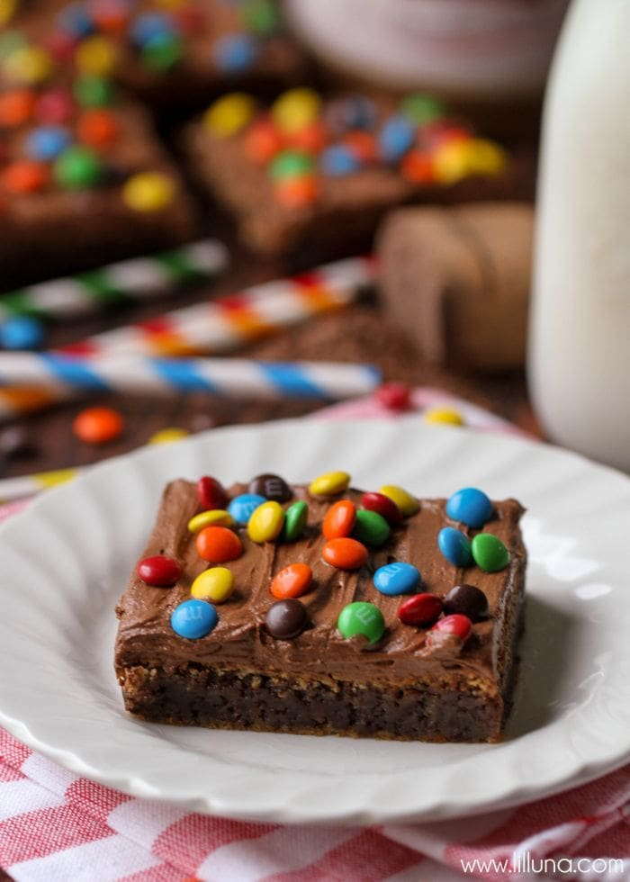 Homemade Fudgy Brownies with Chocolate Buttercream Frosting topped with mini M&Ms - DELICIOUS! { lilluna.com }