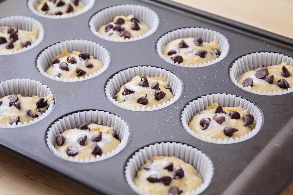 Homemade chocolate chip muffin batter in a baking tin