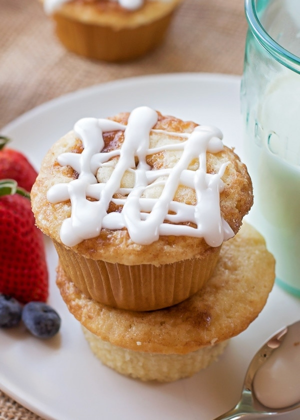 Cinnamon Roll Muffins Recipe stacked on white plate