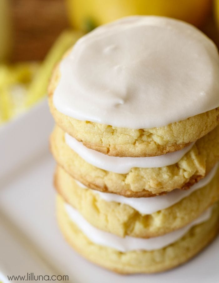 Frosted Cake Mix Lemon Cookies - our new favorite! They are so tasty, lemon-y and delicious! { lilluna.com } Made with a lemon cake mix and topped with a frosting made from powdered sugar, lemon juice, almond extract, vanilla, milk, and butter!