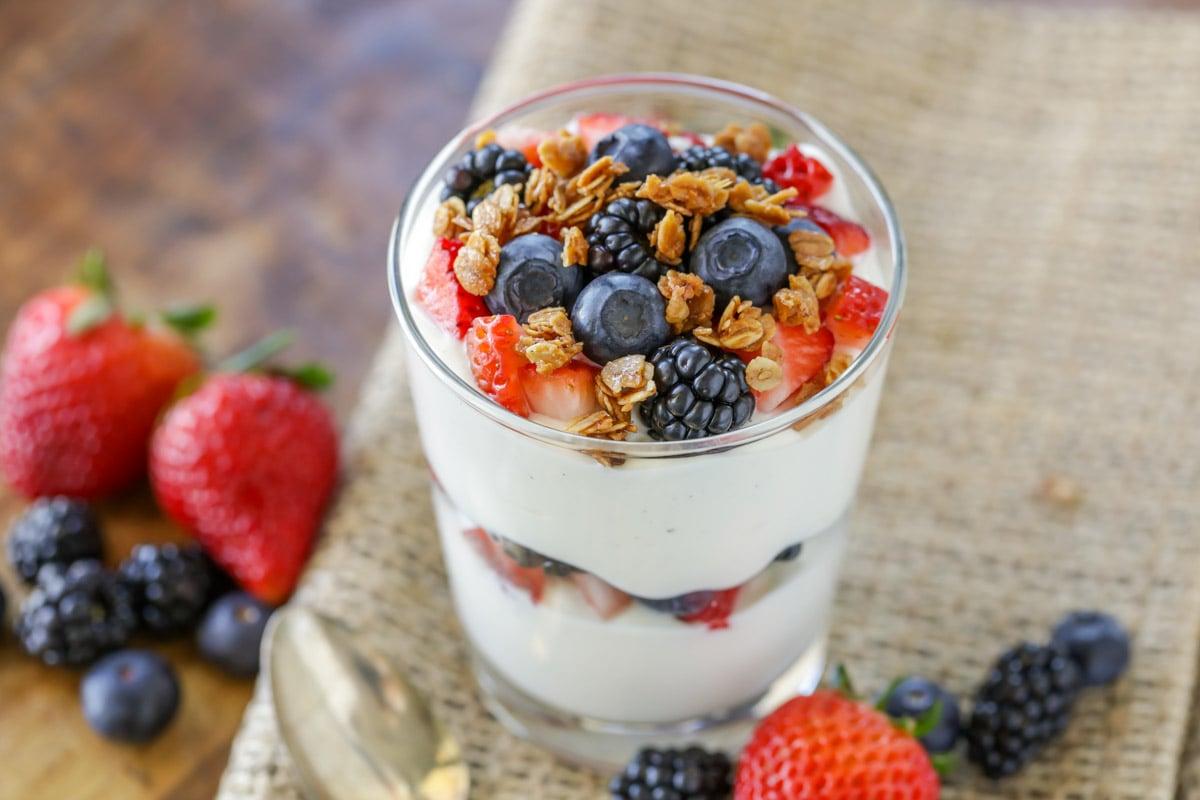 Yogurt parfait layered with fresh fruit and granola