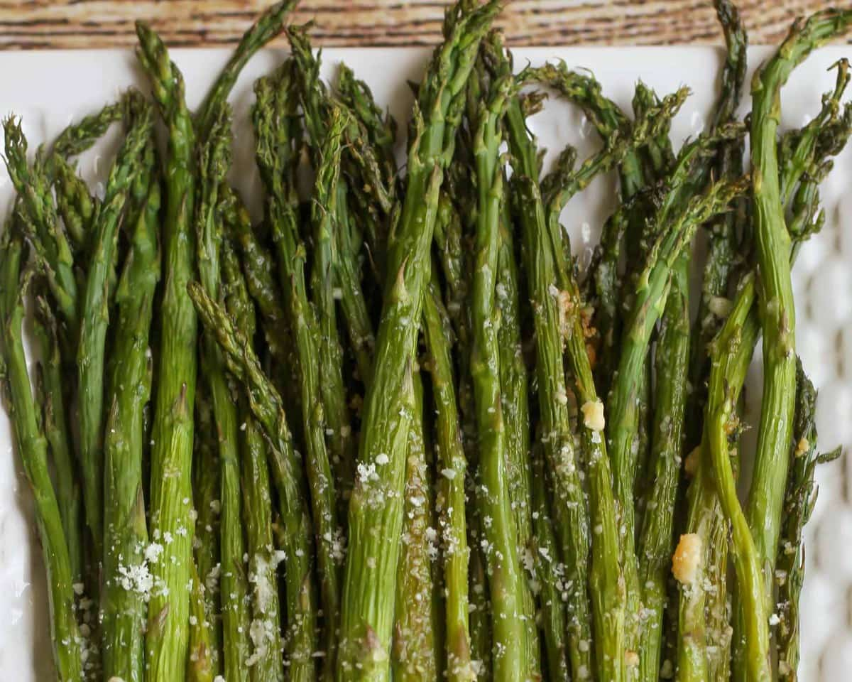 Parmesan Asparagus on a white platter