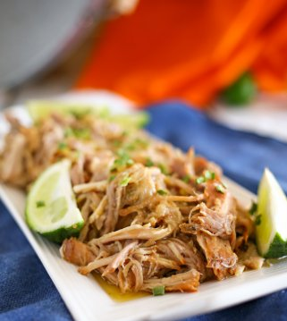 Sweet Pork Barbacoa with lime wedges