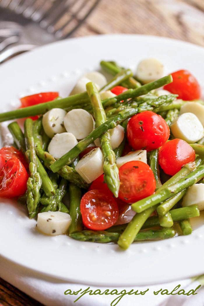 Quick and simple Asparagus salad filled with cheese and cherry tomatoes - our new favorite salad!!