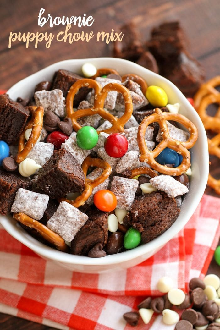 Brownie Puppy Chow Mix filled with brownie chunks, preztels, peanut butter M&Ms, and white and milk chocolate chips! { lilluna.com }