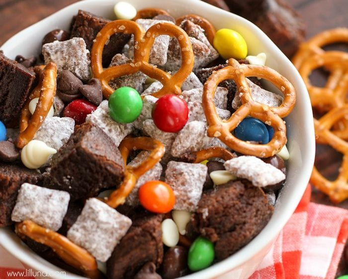 Brownie Puppy Chow Mix filled with brownie chunks, pretzels, peanut butter M&Ms, and white and milk chocolate chips! { lilluna.com }