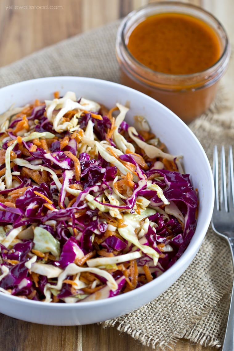 Disneyland's Big Thunder Ranch Copycat Coleslaw recipe - so delicious! { lilluna.com } Red and green cabbage and shredded carrots mixed with red wine vinegar, celery salt, cayenne pepper, and paprika!!