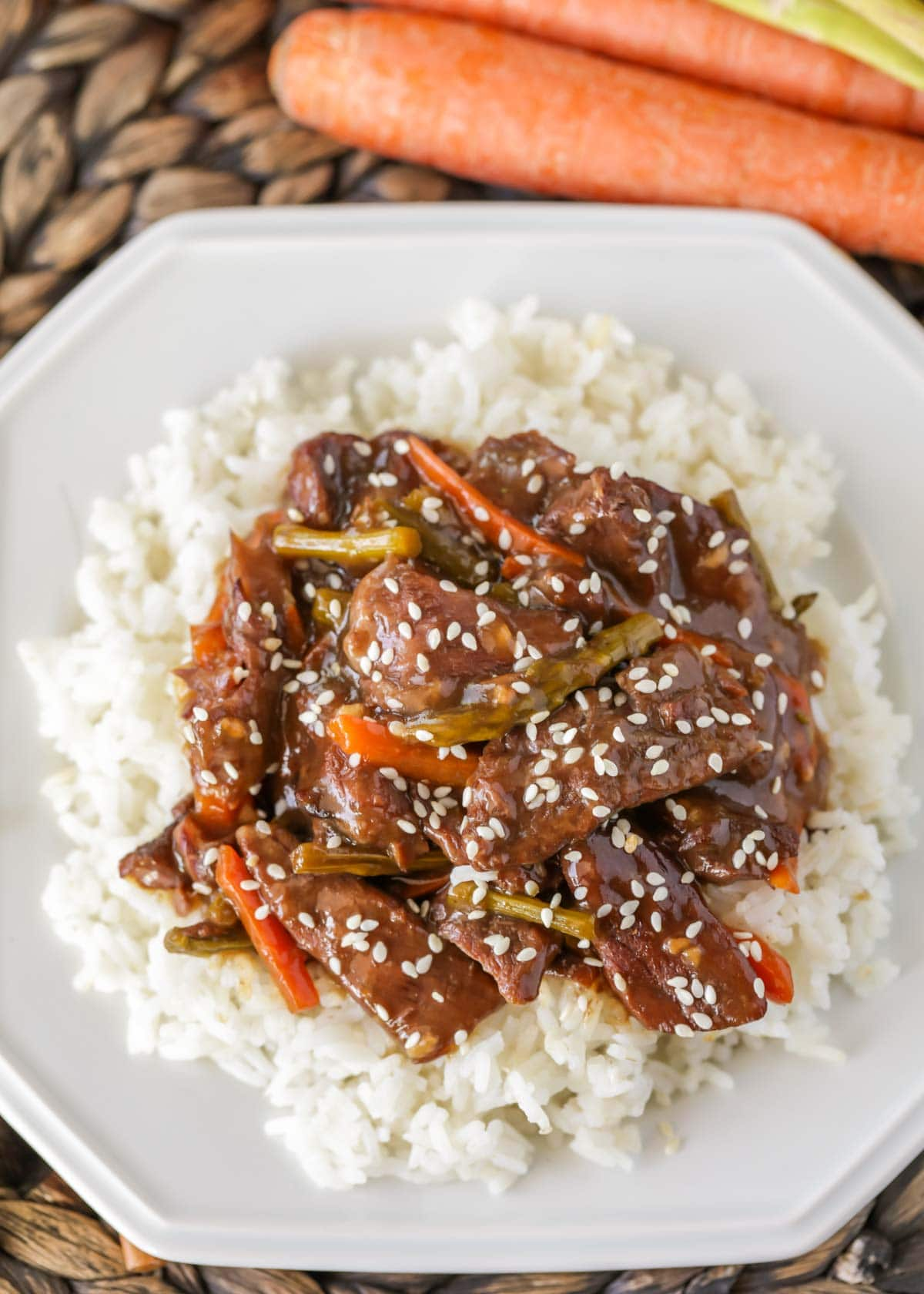 mongolian beef served on a bed of white rice