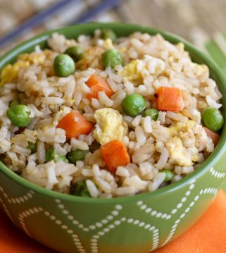 homemade fried rice with eggs, peas and carrots