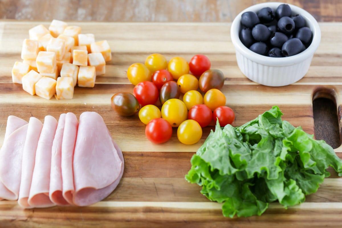 Lunch kabob ingredients on cutting board