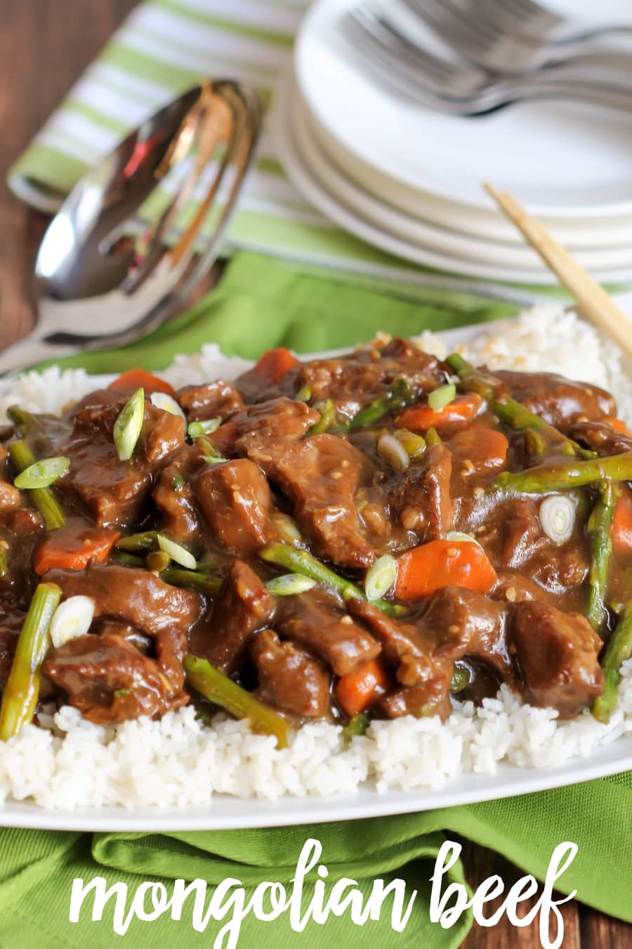Crock Pot Mongolian Beef - SO simple and delicious. It will be a new favorite! Recipe on { lilluna.com } Your crockpot does all the work! Mix your asparagus, carrot, and seasonings together and add your chuck roast!