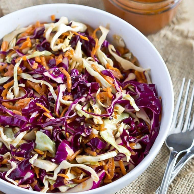 Sweet and Tangy Coleslaw in a white bowl.