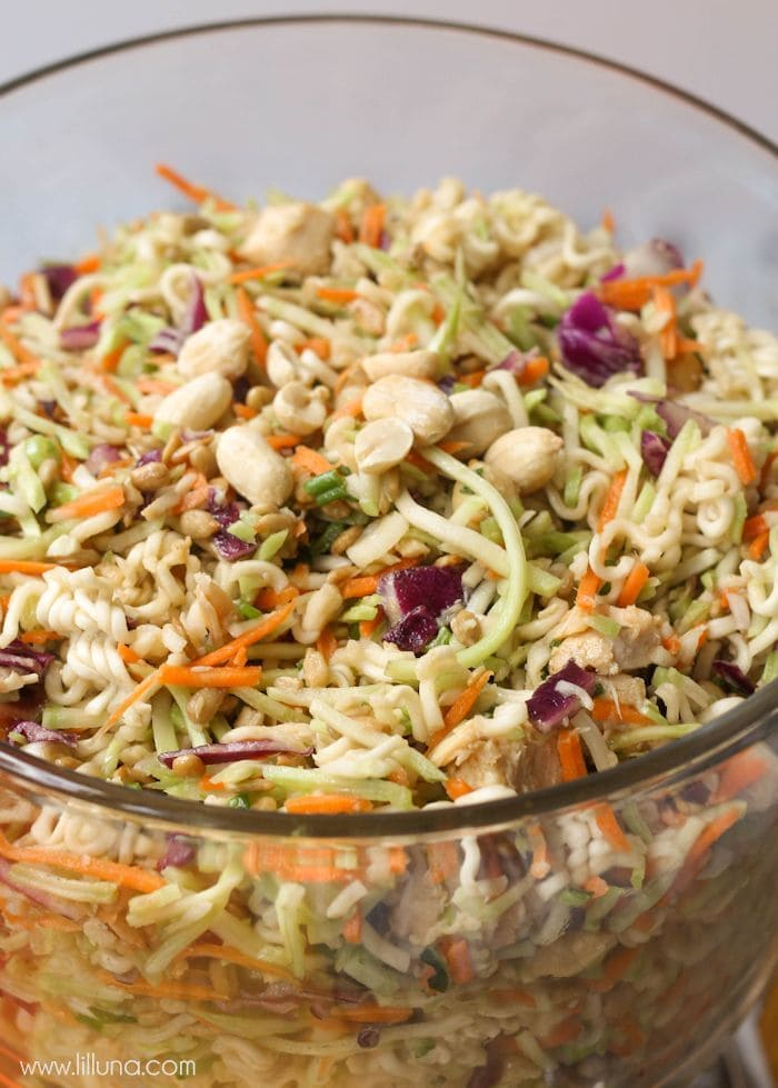 One of the quickest and yummiest side dishes you'll every try - Broccoli Slaw. Get the recipe on { lilluna.com } Recipe is full of broccoli slaw, green onions, oriental ramen noodles, peanuts, and sunflower seeds in a delicious dressing!