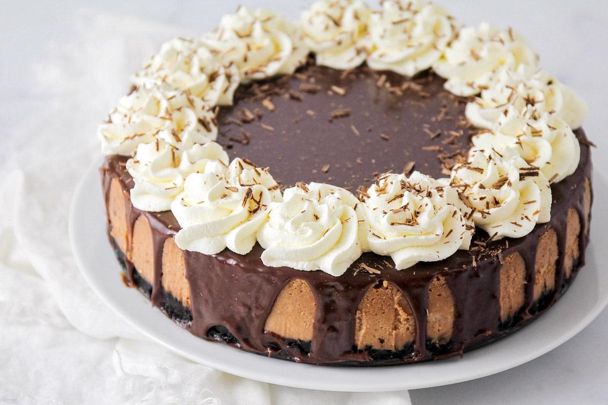 Milk chocolate cheesecake with ganache and whipped cream