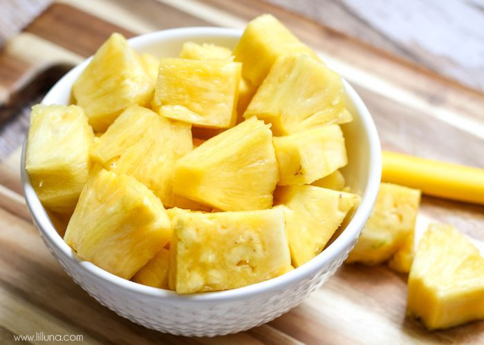 cubes of pineapple in a white bowl