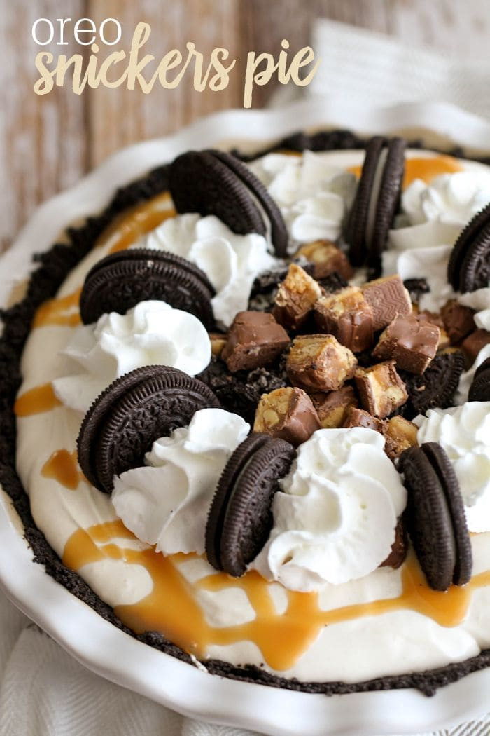 Oreo Snickers Pie - a delicious pie with Oreo Crust, snickers, and a creamy, rich filling sure to knock your socks off! { lilluna.com }
