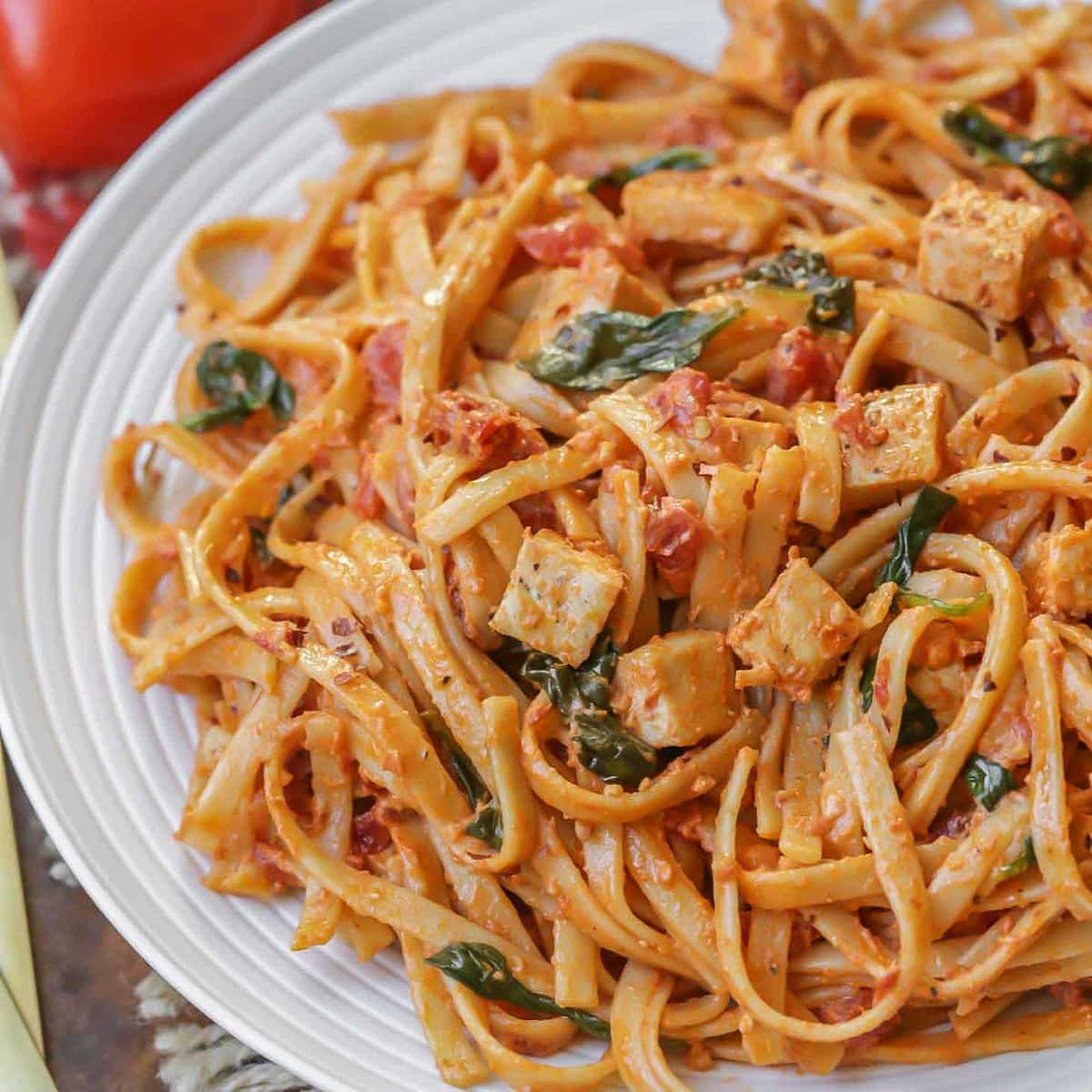 Sun Dried Tomato Pasta with chicken and spinach on a plate