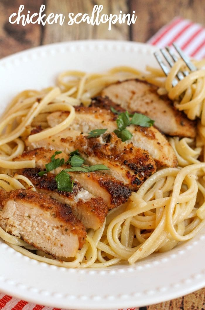Delicious crusted chicken over lemon butter pasta - a new favorite dinner meal! Recipe on { lilluna.com }