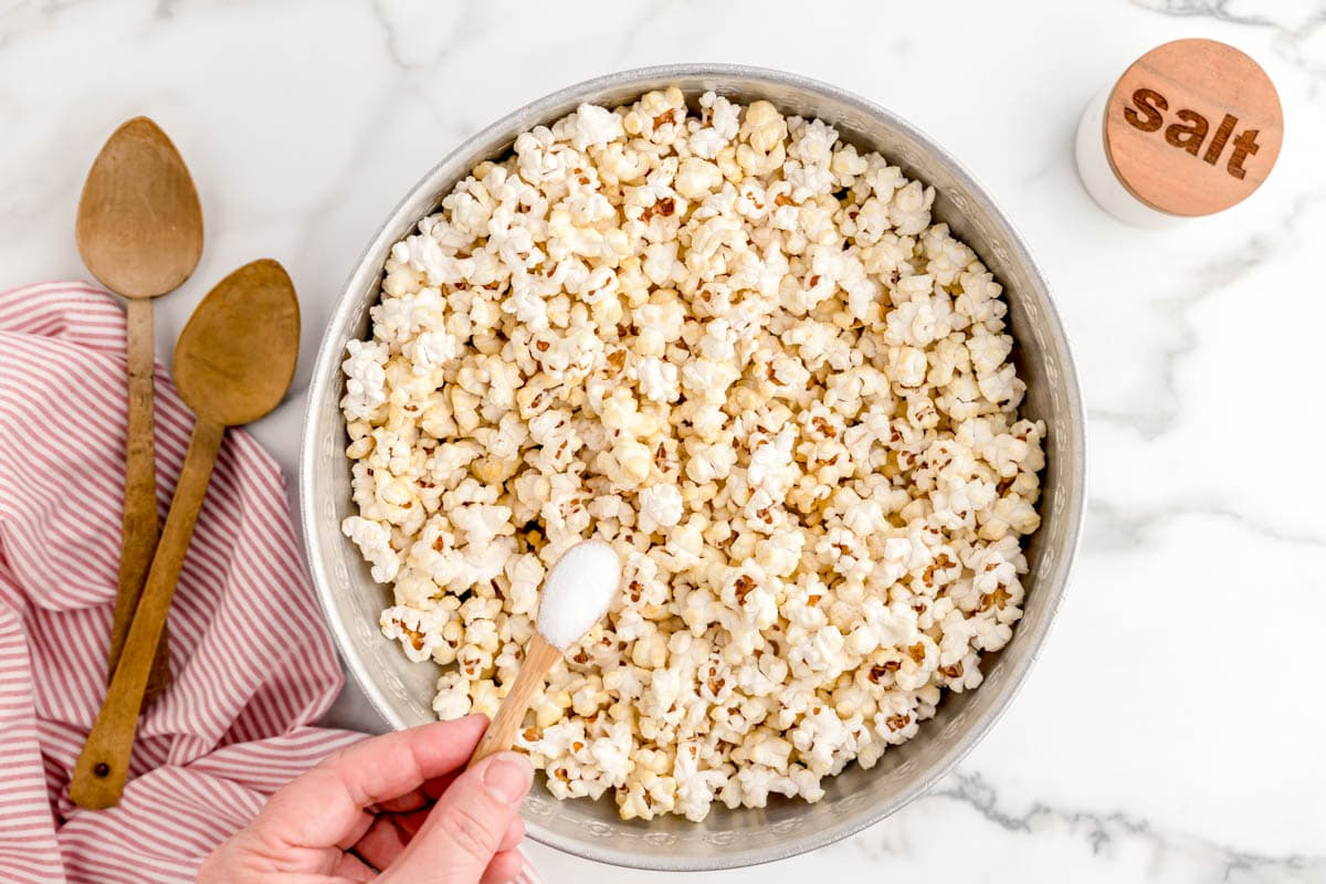 Kettle Corn in the pot with salt sprinkled on top