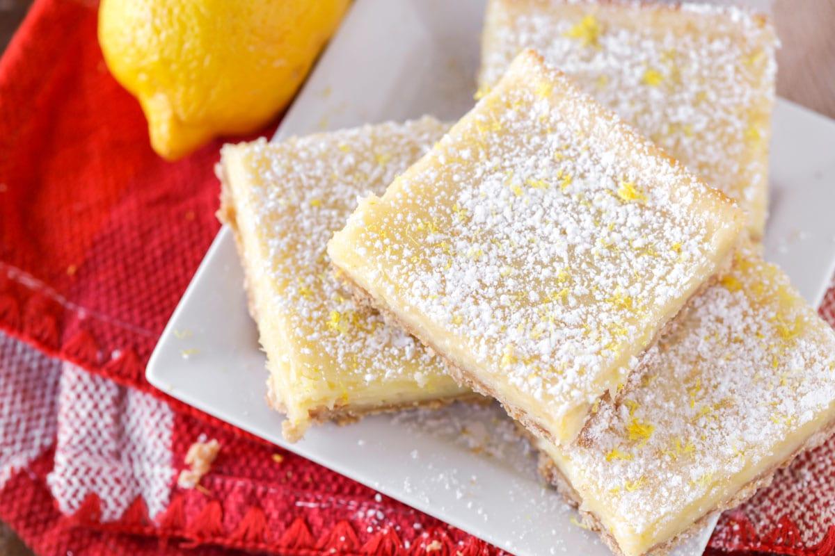 Lemon cream cheese bar recipe on a white plate