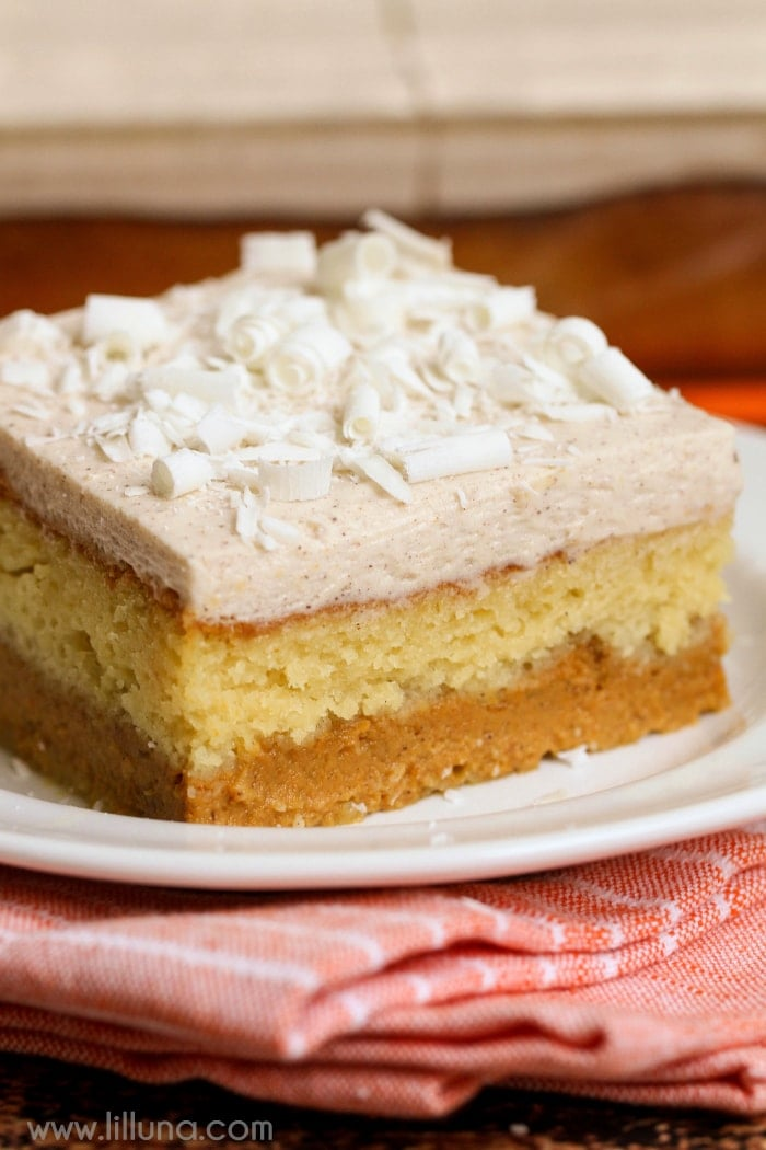 Magic Pumpkin Cake - a 3-layered dessert - yellow cake mix, a pumpkin puree mix, and white chocolate pudding with pumpkin pie spice and cool whip and all topped off with white chocolate curls!! Get the recipe on { lilluna.com }