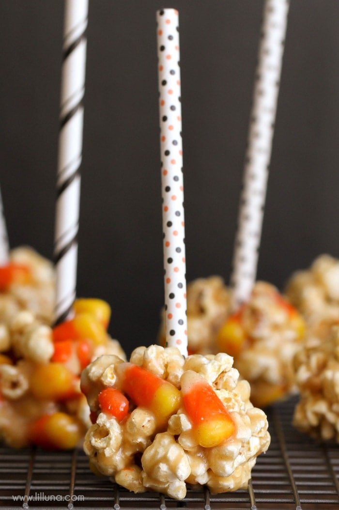 Simple and delicious Fall Popcorn Balls - a dessert the whole family will love! Popcorn and candy corn mixed with peanut butter, vanilla, corn syrup, and sugar!!