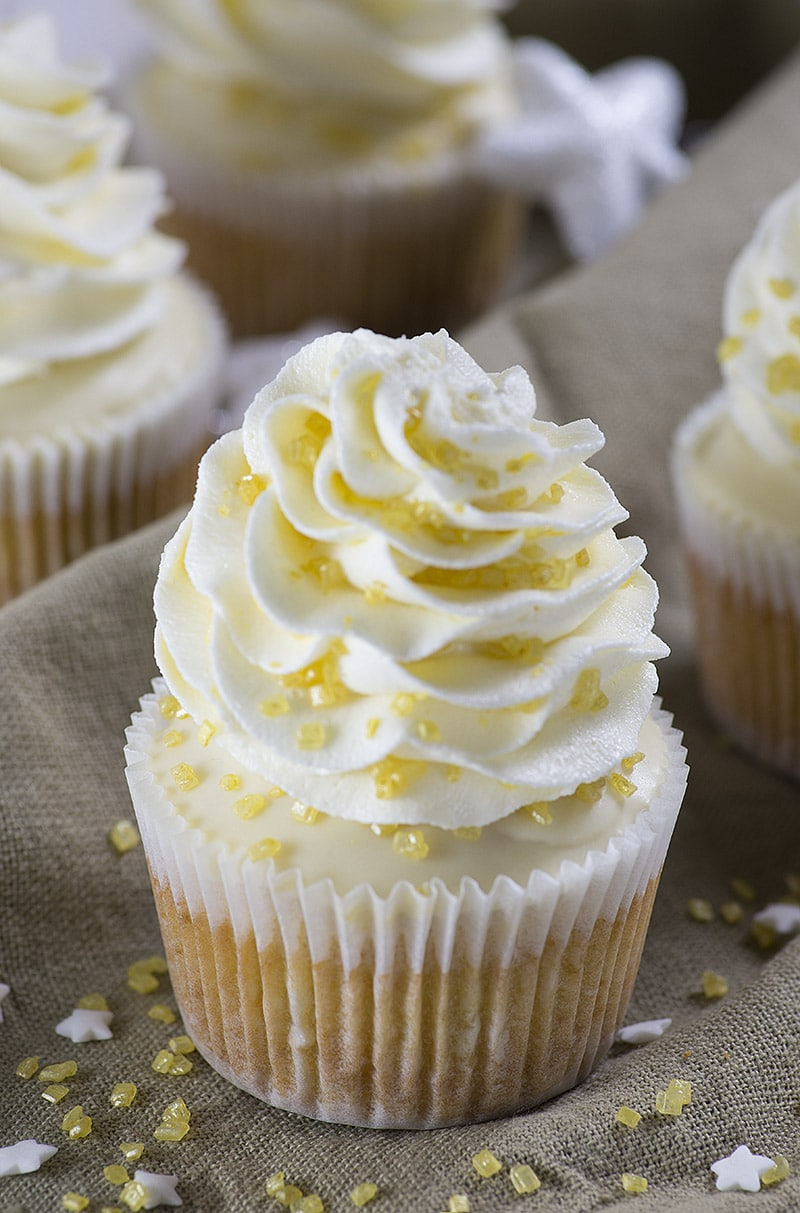 Sparkling Cider Cupcakes - the perfect dessert for any party but especially for New Years Eve!! These cupcakes are so moist from the yogurt and have sparkling cider and white chocolate chips in the batter with sparkling cider also in the frosting!