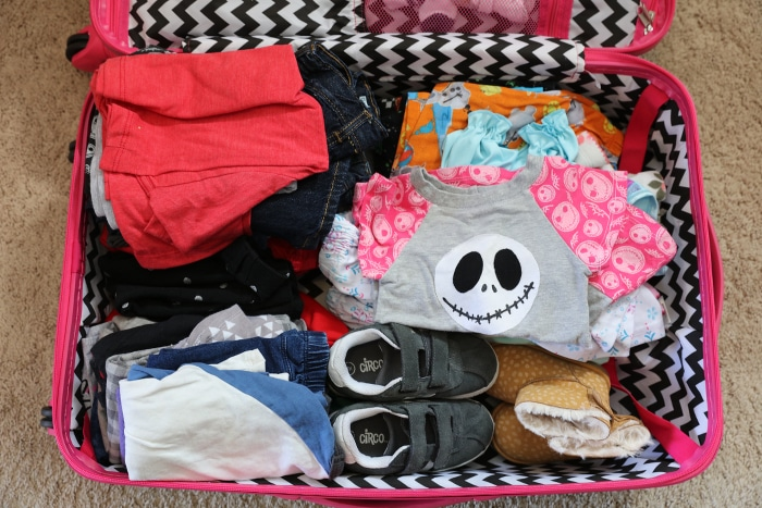 Packing for Disney World - clothes in luggage