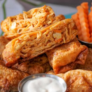 Buffalo chicken egg rolls with ranch dressing in silver cup