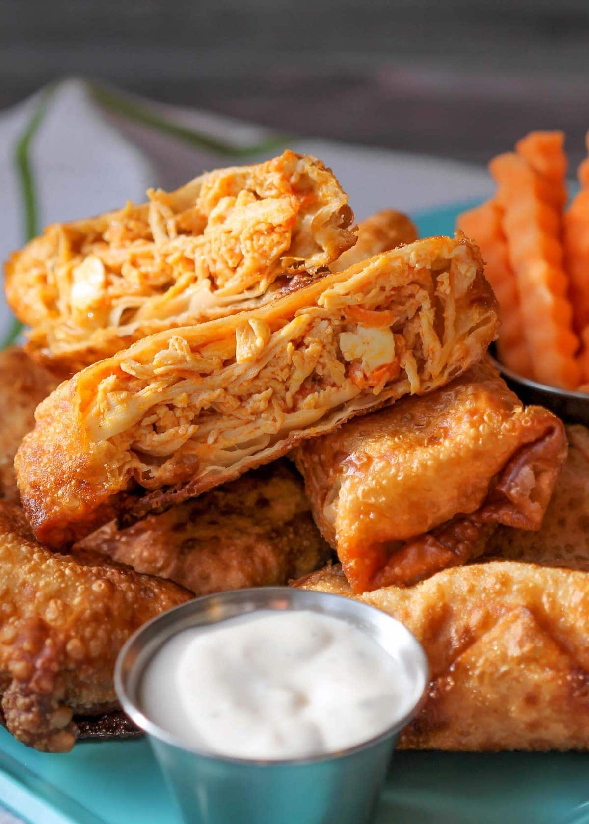 Close up of inside of Buffalo Chicken Egg Rolls with ranch dip